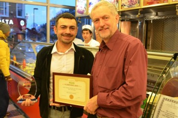 Jeremy Corbyn poses with owner Hakan Topkaya at Archway Kebabs after it won an award. Photo: Islington Now